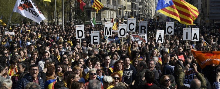 People demonstrate in Barcelona against the trial of former Catalan separatist leaders held in Madrid, during a strike day on 21 February 2019. Picture: AFP