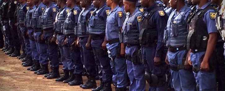 More than three dozen public order police lined up and ready to make sure all is peaceful at the Union Buildings. Picture: Barry Bateman/EWN.
