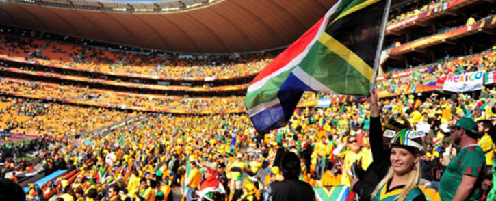 FILE: Soccer fans attend the opening ceremony of the first World Cup ever held in Africa at Soccer City, on 11 June 2010. Picture: SAPA stringer