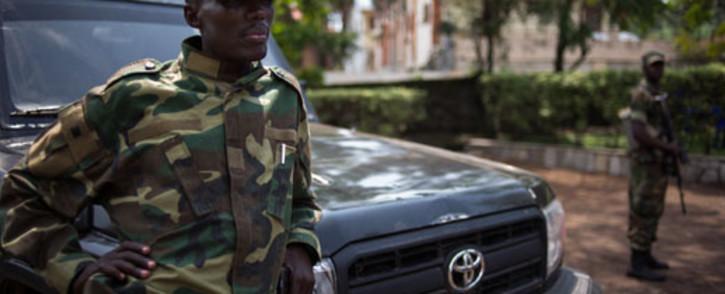 The head of the M23 rebel military forces, Brigadier-General Sultani Makenga leans on a car on November 25, 2012 on the grounds of a military residence. Picture: AFP.
