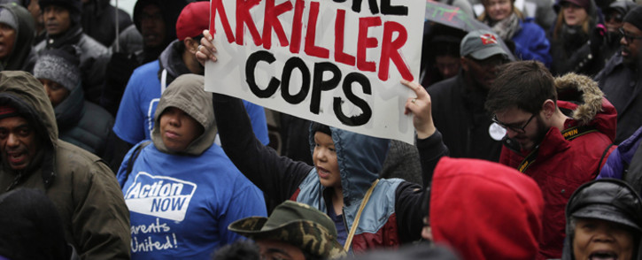 FILE: Demonstrators protest the shooting of Laquan McDonald along the Magnificent Mile 27 November, 2015 in Chicago, Illinois. Picture: AFP.