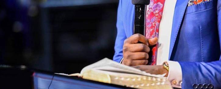 FILE: Pastor Shepherd Bushiri reads the Bible during a church service at his Enlightened Christian Gathering Church. Picture: @shepherdbushiriministries/Facebook.com.