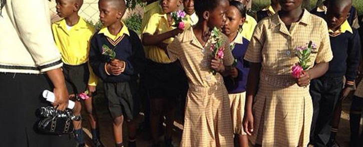 FILE: Michael Komape's classmates are gathered outside his house in Limpopo for his funeral service. Picture: Masego Rahlaga/EWN