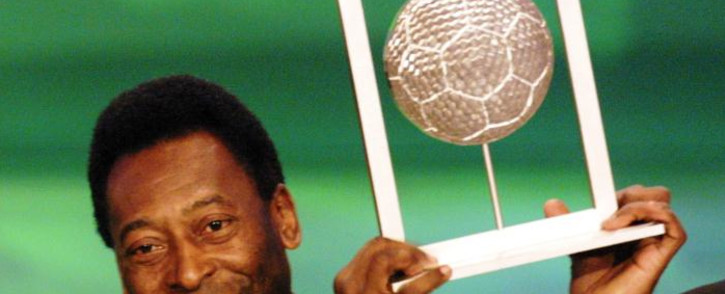 "Brazilian former soccer player Pele holds his Fifa grand prix of ""Footballer of the century"" on 11 December 2000. Picture: AFP."