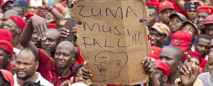 "A protester holds up a placard at the ""Day of Action"" march against the leadership of President Jacob Zuma held in Pretoria on 12 March 2017. Picture: Reinart Toerien/EWN"