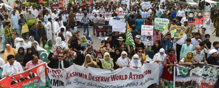 Activists of the ruling Pakistan Tehreek-e-Insaf (PTI) party take part in an anti-India protest march in Lahore on 5 August 2019, in reaction to the move by India to abolish Kashmir's special status. Picture: AFP