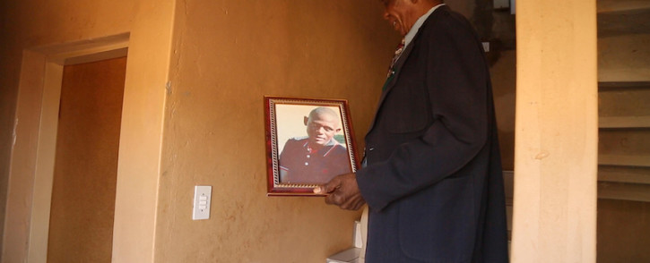 Johannes Rahube with a portrait of his son Osiah, who was killed in a protest in Mothutlung in January 2014. Picture: Xanderleigh Dookey/EWN