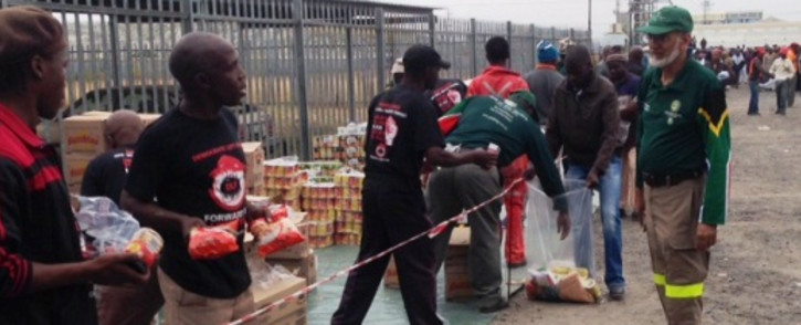 FILE: Relief group the Gift of the Givers hands out food parcels to striking Amcu miners at Anglo American Platinum in Rustenburg on 20 May 2014. Picture: Vumani Mkhize/EWN.