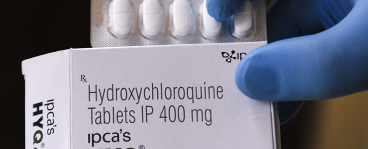 FILE: In this file photo taken on April 26, 2020 a vendor shows hydroxychloroquine (HCQ) tablets at a pharmacy\. Picture: AFP.