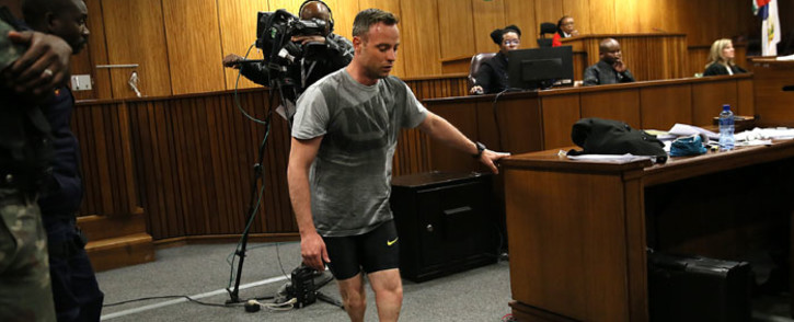 Oscar Pistorius walks on his stumps during a demonstration in court on 15 June 2016. Picture: Pool.