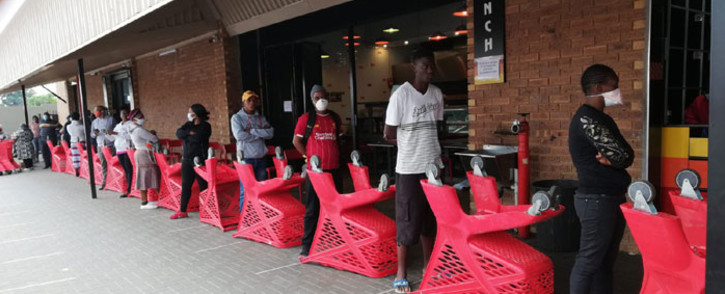 Social distancing is enforced at a shopping centre where social grant recipients are collecting their payouts on 30 March 2020. Picture: @The_DSD/Twitter
