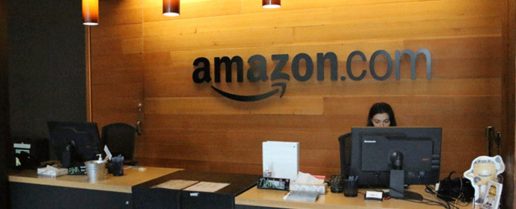 FILE: Nikol Szymul staffs a reception desk at Amazon offices discretely tucked into a building called Fiona in downtown Seattle, Washington on 11 May 2017. Picture: AFP.