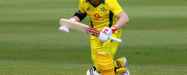 FILE: Australia batsman David Warner calls for a run. Picture: AFP