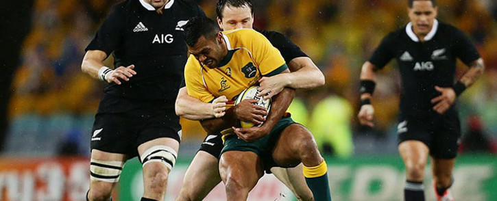 Ben Smith takes down Kurtley Beale while skipper Richie McCaw prepares to join ruck in Sydney on 16 August 2014. Picture: Facebook.