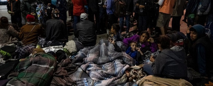 A group of Central American migrants, mostly from Honduras, moving towards the United States, rest near El Chaparral port of entry at the US-Mexico border after a demonstration as Federal Police guards in Tijuana, Baja California state, Mexico, on 22 November 2018. Picture: AFP