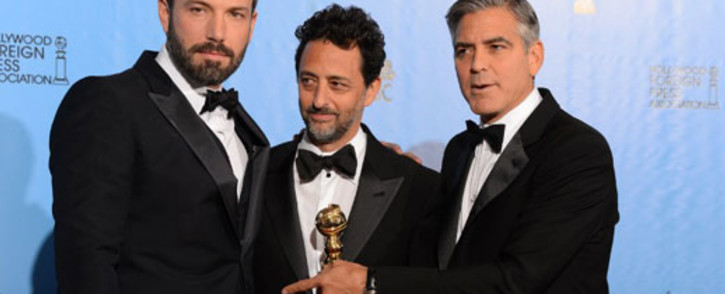 """Actor/director Ben Affleck (L) poses with producers Grant Heslov (C) and George Clooney with the award for best motion picture drama for """"Argo"""" at the Golden Globes awards ceremony in Beverly Hills on 13 January 2013. Picture: AFP"""