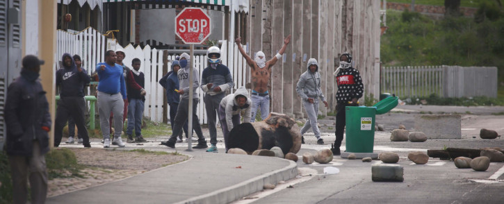 FILE: Hangberg protesters block roads leading to the community using rocks and bins during a standoff with police. Photo: Bertram Malgas/EWN