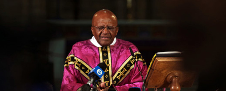 Anglican Archbishop Emeritus Desmond Tutu leads a service at the St George's Cathedral in Cape Town on 6 December 2013. Picture: SAPA.