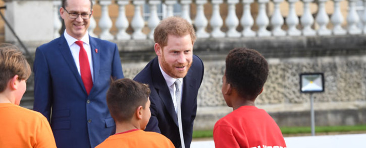 Britain's Prince Harry, Duke of Sussex gestures as he chats to school children prior to the draw for the Rugby League World Cup 2021 at Buckingham Palace in London on 16 January 2020. Picture: AFP