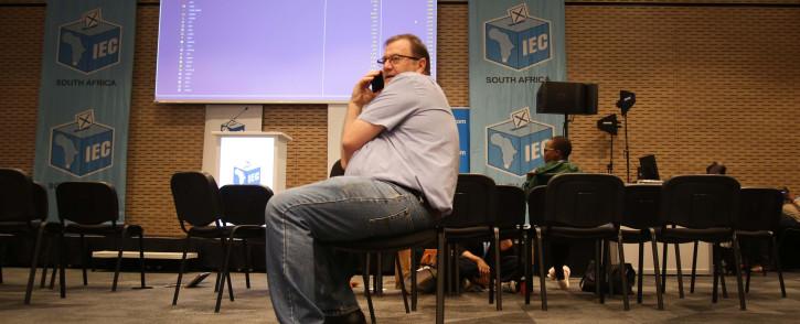 FILE: The DA's Anton Bredell sits in front of the results board at the IEC Results Centre in Cape Town. Picture: Bertram Malgas /EWN