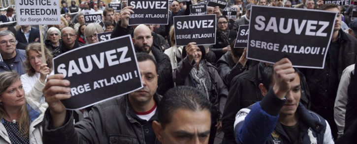 """FILE: Protesters hold signs reading """"Save Serge Atlaoui"""" on 25 April, 2015 during a rally near the city hall and cathedral of Metz, eastern France, in support of French national Serge Atlaoui, on death row in Indonesia for drug trafficking. Picture: AFP."""