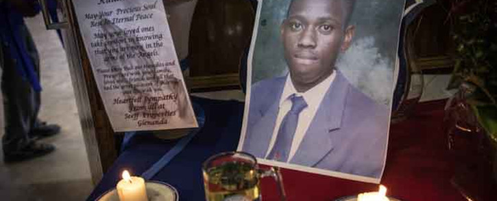 FILE: A picture of Mondeor High School pupil Kulani Mathebula is seen in front of candles during a memorial service. Picture: Abigail Javier/EWN.