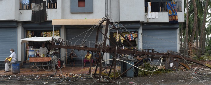 A damaged electricity transformer lies on the ground in Mahuva on 19 May 2021, after Cyclone Tauktae hit the west coast of India with powerful winds and driving rain, leaving at least 55 people dead and almost 100 missing. Picture: Sam Panthaky / AFP