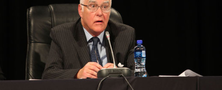 Ian Farlam listens to comments made on day one of the Farlam Commission into the Marikana shooting. Picture: Taurai Maduna/EWN.