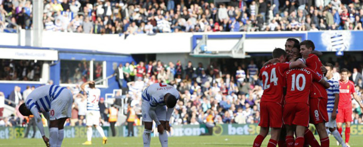 Liverpool players celebrate after getting their third goal during the English Premier League football match between Queens Park Rangers and Liverpool at Loftus Road in London on October 19, 2014. Picture: AFP