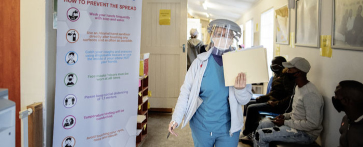 FILE: A doctor walks in the Respiratory & Meningeal Pathogens Research Unit (RMPRU) at Chris Hani Baragwanath Hospital in Soweto on 14 July 2020. Picture: AFP.