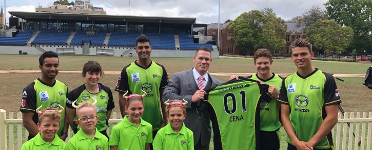 John Cena with the Sydney Thunder players.  Picture: Twitter/@JohnCena
