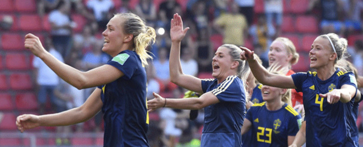 Sweden's players celebrate at the end of the France 2019 Women's World Cup quarter-final football match between Germany and Sweden, on 29 June, 2019, at the Roazhon park stadium in Rennes, north western France. Picture: AFP.