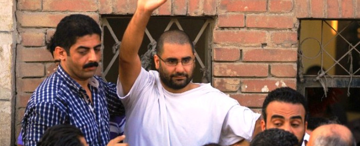 Alaa Abdel Fattah (C) was released on bail today and will have his case transferred to another court. Picture: AFP.