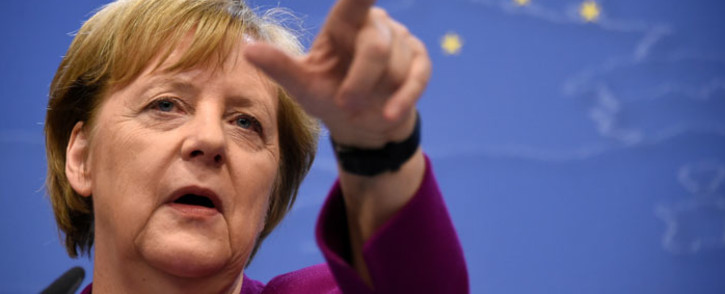 FILE: Germany's Chancellor Angela Merkel gestures as she addresses media representatives after a European Union (EU) summit at EU Commission Headquarters in Brussels on 28 May 2019. Picture: AFP.