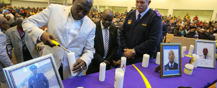 Police Minister Bheki Cele (left) and National Police Commissioner Khehla Sitole (centre) attending a memorial service for three police officers killed in Cape Town. Picture: @SAPoliceService/Twitter