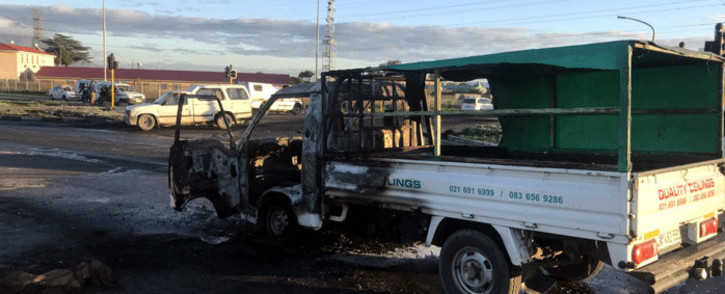 A municipal truck was torched during a protest  in Gugulethu, on 25 May 2018. Picture: Shamiela Fisher/EWN