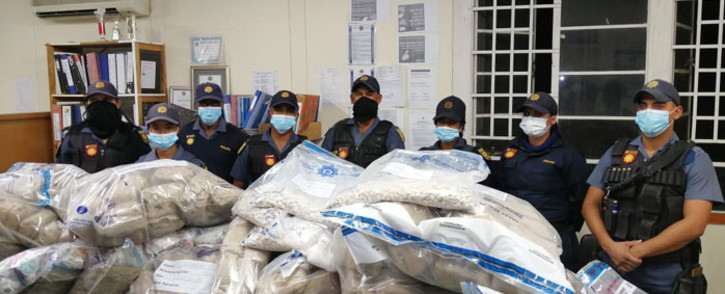 Springbok Public Order Policing unit members with the drugs confiscated from a truck driver on 7 June 2020. Picture: @SAPoliceService/Twitter