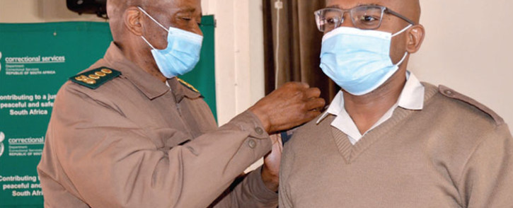 Chief Deputy Commissioner (CDC): Incarceration and Corrections, Samuel Makgothi Thobakgale (right), gets his new insignia from acting National Commissioner Mandla Mkabela. Picture: Department of Correctional Services