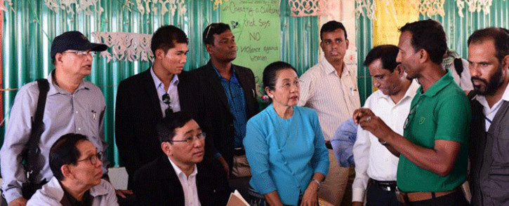 Myanmar Social Welfare Minister Win Myat Aye (lower 2nd L) talks to Rohingya refugees during his visit to the Kutupalong refugee camp in Bangladesh's Ukhia district on 11 April, 2018. Picture: AFP.