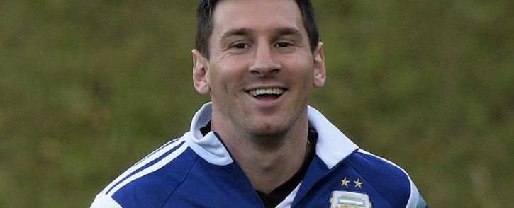 FILE: Argentina's forward Lionel Messi jogs during a training session at Cidade do Galo. Picture: AFP.