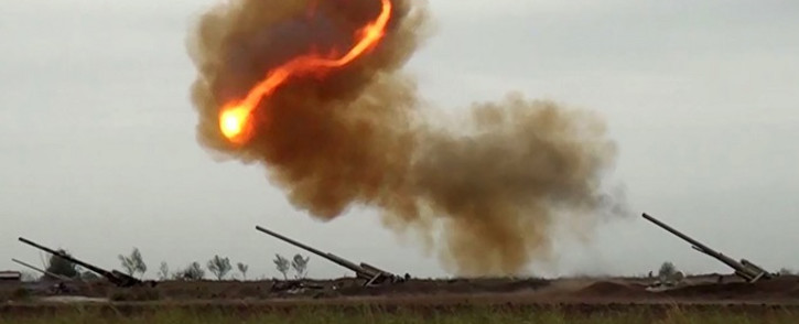 FILE: An image grab taken from a video made available on the official web site of the Azerbaijani Defence Ministry on 28 September 2020 allegedly shows Azeri artillery strike towards the positions of Armenian separatists in the breakaway region of Nagorno-Karabakh. Picture: AFP