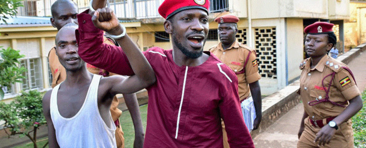 FILE: Opposition figurehead Hon Kagulanyi Robert, aka Bobi Wine, walks handcuffed together with another prisoner before boarding the prison bus leading him to Luzira maximum prison in Kampala on 29 April 2019. Picture: AFP.
