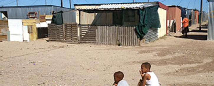 FILE: Two non-school going boys while away the hours in Blikkiesdorp. Picture: EWN