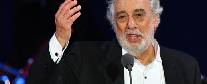 FILE: Spanish tenor Placido Domingo gestures as he performs during his concert in the newly inaugurated sports and culture centre 'St Gellert Forum' in Szeged, southern Hungary, on 28 August 2019. Picture: AFP