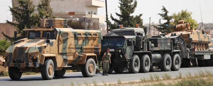 Turkish forces are seen in a convoy on a main highway between Damascus and Aleppo, near the town of Saraqib in Syria's northern Idlib province, on 29 August 2018. Picture: AFP.