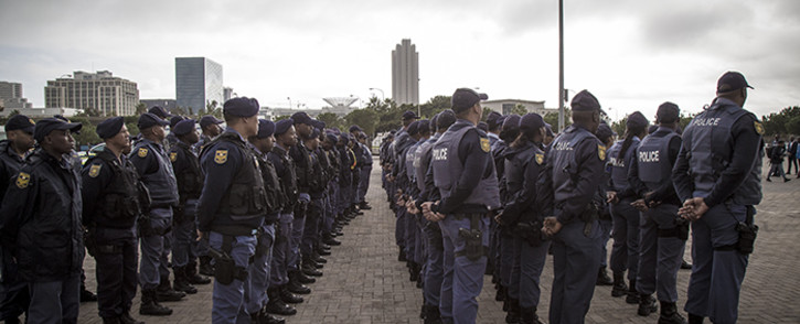 Saps officers line the Grand Parade in Cape Town before an operation in the CBD. Picture: Thomas Holder/EWN