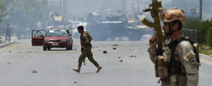 FILE: Afghan security personnel take position at the site of an attack in front of the parliament building in Kabul on 22 June 2015. Picture: AFP.