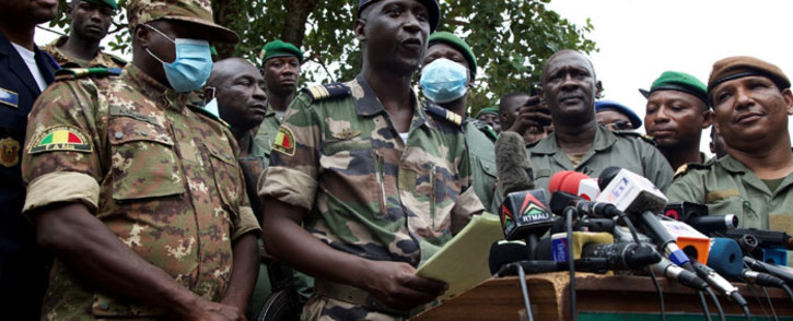 Malian Air Force deputy chief of staff Ismael Wague (front row 2nd L) speaks during a press conference in Kati, Mali on 19 August 2020. Coup leaders in Mali faced a wave of international pressure a day after they forced out Malian President Ibrahim Boubacar Keita weakened by months of mass protests. Picture: AFP