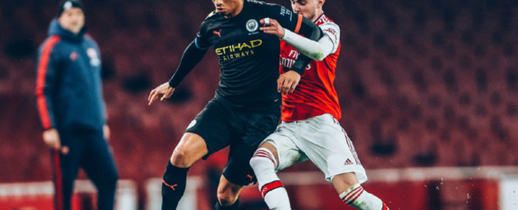 Manchester City's Leroy Sane (in black) takes on his Arsenal opponent. Picture: @LeroySane19/Twitter