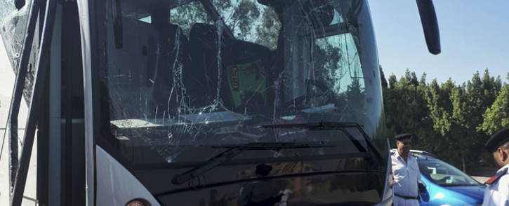 A picture taken on 19 May 2019, shows a bus damaged during a bomb blast near Egypt's famed Giza pyramids. Picture: AFP